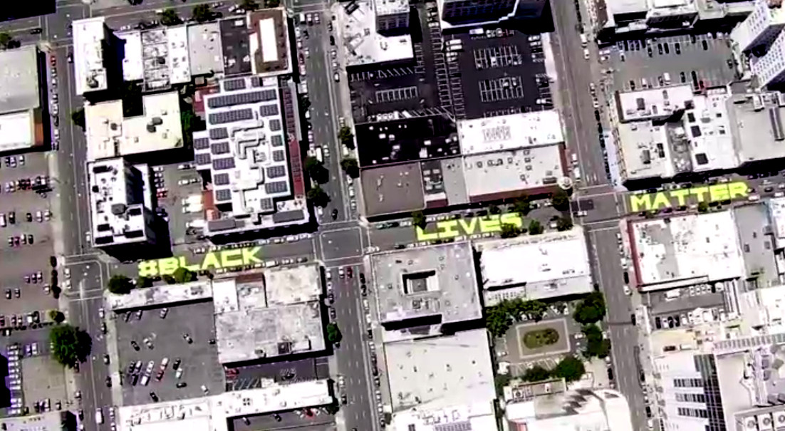 Aerial view from NBC chopper of Fulton Street with letters painted on it: #BLACK LIVES MATTER