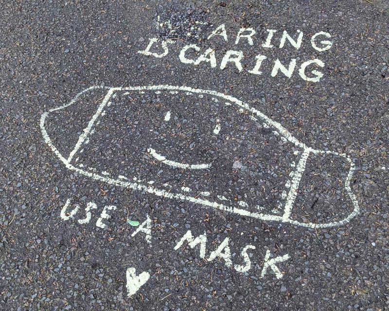 sidewalk art: Wearing Is Caring; happy mask logo; Use A Mask; heart